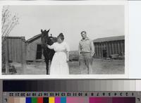 Emma Phillips and Harold Thorsen with horse on Phillips Ranch.