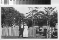 Harry Phillips Sr. and his wife, Mary Ann in front of their home.