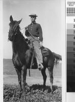 "Harry Phillips Jr. on his horse ""Bird."""