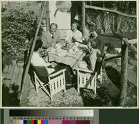 Five people seated at an outdoor table