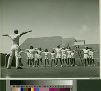 Group of female students exercising on an outdoor sport court