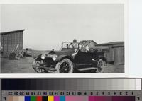 Buick on the Phillips Ranch with two male passengers