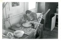 Man working at a potter's wheel