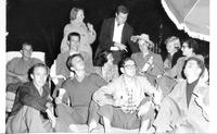 Group of students seated outdoors at night