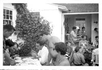 Group of students seated on outdoor patio