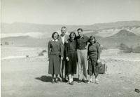 Group of people with hills in the distance