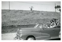 Convertible with six people