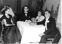 Group of four people seated at a table