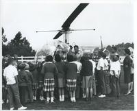 Los Angeles County Sheriff helicopter with group of children