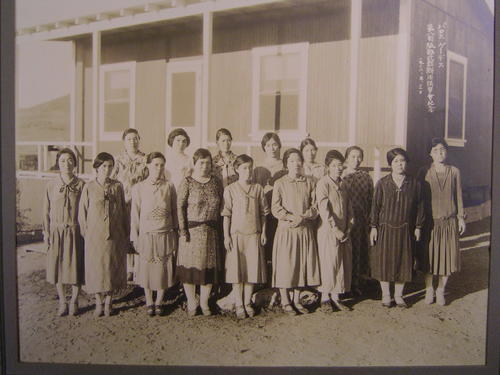 "Image shows group of women in western-style clothing standing in front of the single-story wood structure of the Palos Verdes Nihongo Gakuen school building.  A sign in Japanese inscribed in white ink in the upper right-hand corner reads:  ""Palos Verdes Palos Verdes No. 8 Sakabe Method [?Cutting] Seminar Commemoration 1938. 9.3""., Library has digital image only, courtesy of Mutsuo Hirose., Title translated from Japanese."