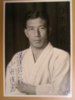 """Toshitaka Yamauchi, Kodokan - roku dan"" [6th level, purple belt]"