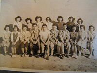 Group portrait of young women and men, Poston, Arizona