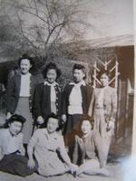 Group portrait of seven women, Poston, Arizona