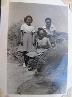 Group portrait of two women and a man, Poston, Arizona