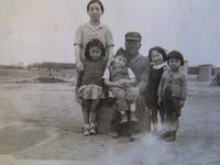 Group portrait of Yutaro Kawashiri, his two grandchildren, Naka Motoike, and...