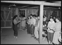"""""""Poston, Arizona. On the night of the arrival of the first evacuees of Japanese..."""