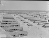 """Poston, Arizona. Living quarters of evacuees of Japanese ancestry at this War..."