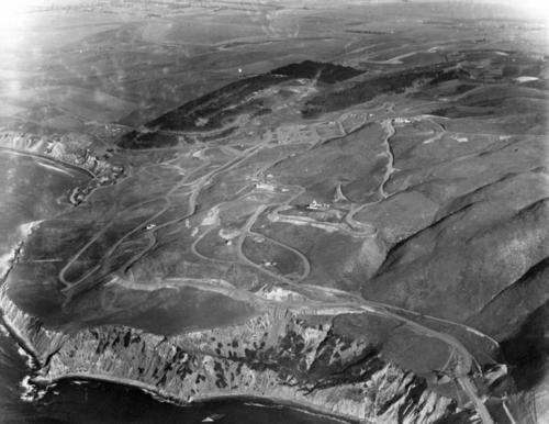 Image shows aerial view of  the Palos Verdes Peninsula looking north. Visible are long and winding roads, coasts, and scattered houses., Library has digital image only, courtesy of the Los Angeles Public Library., Los Angeles Public Library Photo Collection Identifier:00023094., Title taken from the Los Angeles Public Library., Originally from the Security Pacific National Bank Collection.